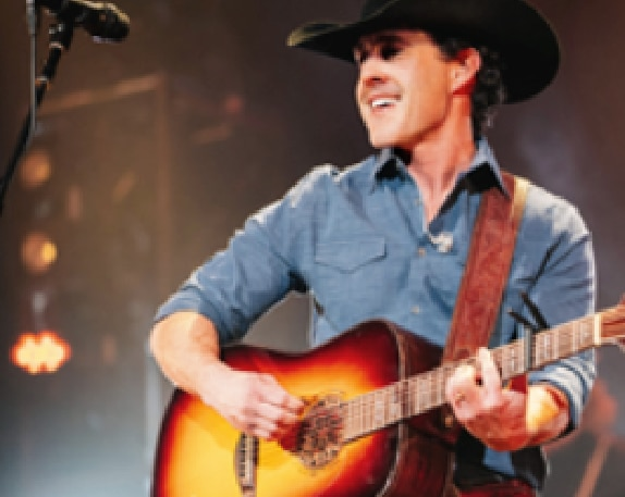 Aaron Watson playing guitar at Rodeo Austin 2019